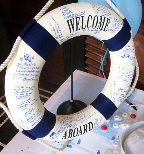 "Life preserver ""guest book"" for nautical theme wedding. Instead of ""welcome aboard,"" it could have the couple's name and date."