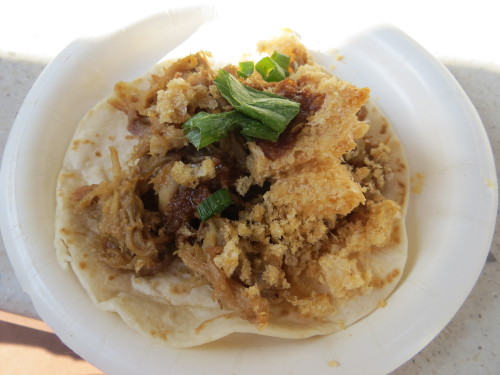 disneyfoodislove:  Taco de Carnitas (Pork carnitas topped with Tamarindo salsa, served on a flour tortilla with pork rinds) from Jardin de Fiestas in the Mexico pavilion during the Flower & Garden festival in Epcot.