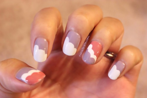 A year ago, I posted a tutorial on scalloped nails. I loved the way those nails looked and decided to change it up a little. This time around, I used purple and pink as my base colors and only painted 3 layers on my thumb & ring fingers, leaving the rest of my nails with white edges.