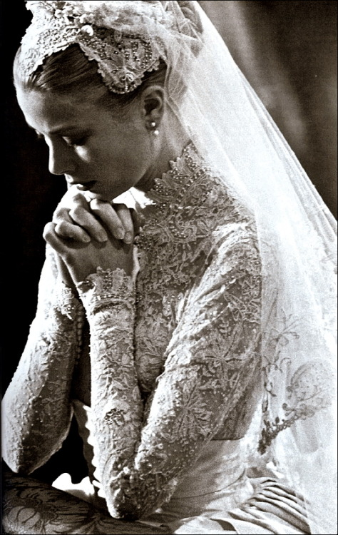 "chiffonandribbons:  Princess Grace Kelly during her legendary wedding to Rainier III, Prince of Monaco Gown by: Helen Rose   ""The wedding dress consisted of a rounded collar, full skirt of ivory peau de soie, and a fitted bodice made from Brussels lace embroidered with seed pearls. The lace was over a century old and had flower designs in it. 25 yards of silk taffeta and 100 yards of silk net were used in the construction of the dress."" Source"