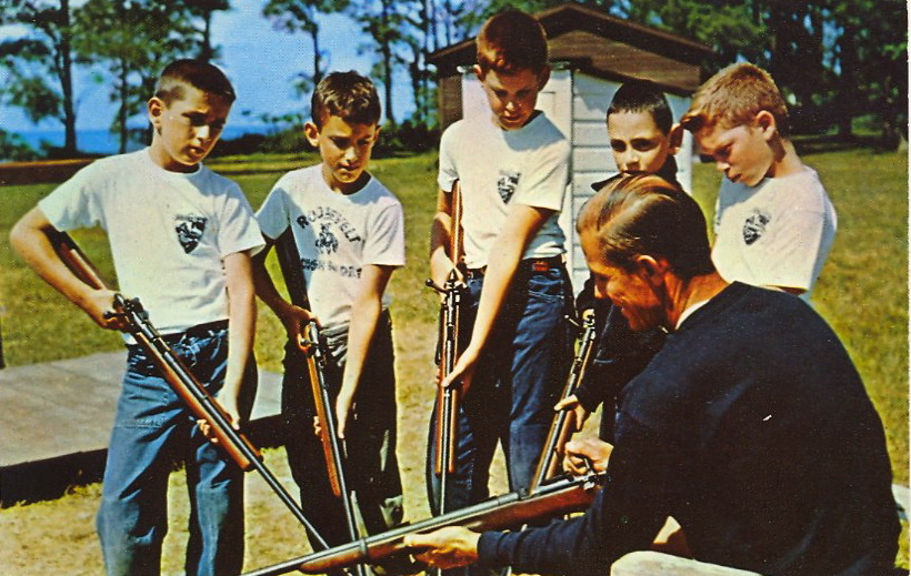 NRA YOUTH GUN APPRECIATION DAY  CAMP ROOSEVELT FOR BOYSPerry, Ohio Bill, the Director, helps his campers to safe marksmanship.