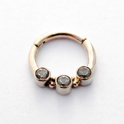 infinitebody:  3-gem hinged ring in 14K white gold with white topaz, from Scylla Jewelry.