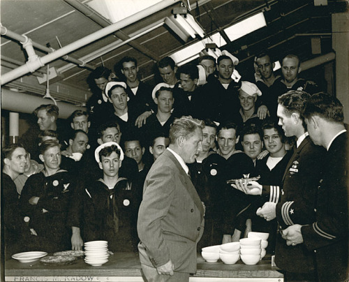 wiscohisto:  Spencer Tracy with commander and crew of the submarine Icefish, Manitowoc, Wisconsin, 1944. On this day in 1900, the actor Spencer Tracy was born in Milwaukee. He went on to star in dozens of films, including Adam's Rib, Father of the Bride, and Inherit the Wind. In this photo, naval officers and crew present Tracy with a model of the Icefish, one of 28 submarines built by the Manitowoc Shipbuilding Company during World War II. via: Manitowoc County Historical Society by way of University of Wisconsin Digital Collections