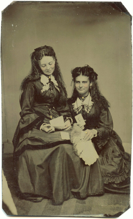 ca. 1870-80's, [tintype portrait of two women admiring cabinet cards and carte de visites] via Ebay