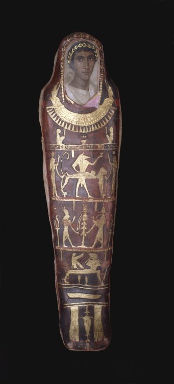 Cartonnage Mummy Case Early 2nd Century AD Roman Period Egypt Mummy of a Greek youth, aged 19-21, named Artemidorus in a cartonnage body-case with mythological decoration in gold leaf and an encaustic on limewood portrait-panel covering the face and inscription on the chest. There is an inscription in Greek on the mummy-case. (Source: The British Museum)