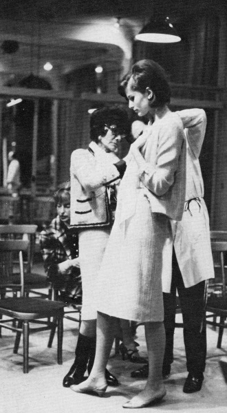 "vintagebinger:  Coco Chanel during one of her infamous inspections the night before a collection was shown. ""[The models] had to endure interminable fittings without uttering a syllable, knowing only too well that Chanel would have remained deaf to their protests, deaf also to their fatigue and that of the tailors, while yet again she undid a jacket, cutting the stitches of an armhole that she would then redo right on the mannequin, using pins to reposition it point by point, all stuck in with an almost demonic thrust — and equally deaf to everything but the creative process that slowly was leading toward perfection."" Photo and quote from Chanel and Her World by Edmonde Charles-Roux."