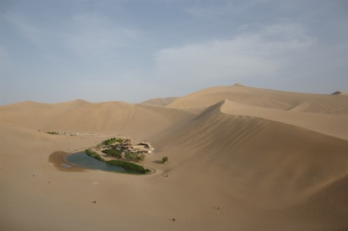 View of the Yueyaquan Crescent Lake Oasis on China's ancient Silk Road, near the city of Dunhuang in China's northwestern Gansu province, on May 12, 2013. © Ed Jones / AFP / Getty Images