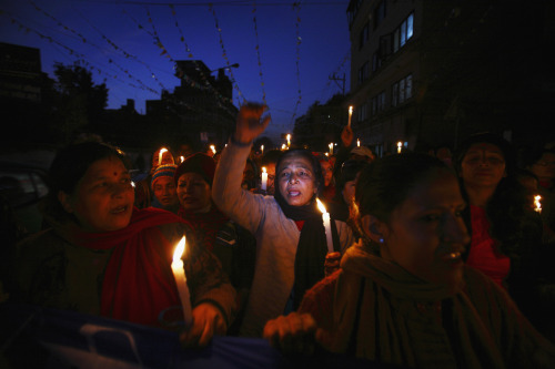 Photo of the Day: Nepalese women participate in a candlelit rally to protest against what they say is an increase in violence against women, demanding the government to implement stronger laws and to take firm action against violence on women, in Kathmandu.  A series of rapes and assaults were reported over the past couple of weeks from all over Nepal, according to local media. (Photo: REUTERS/Navesh Chitrakar)
