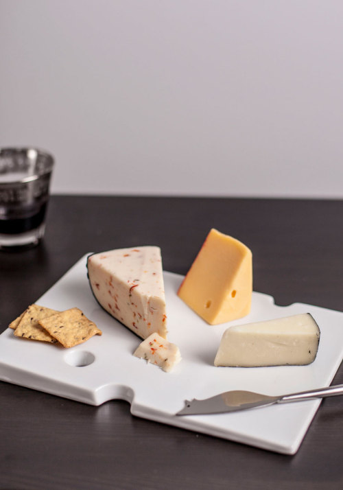 Impress your guests with a cheese spread served on a clever tray! Shop the Best Week Chevre Cheese Plate.