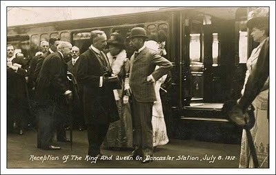 A photograph of the visit of King George V and Queen Mary to Yorkshire in July 1912.  During the visit they stayed at Wentworth Woodhouse as the guests of William, the 7th Earl Fitzwilliam. The intention was for the royal couple to visit what was then the industrial heartland of the British Empire, including the steelworks of nearby Sheffield and the South Yorkshire coalfield which surrounded Wentworth.. The visit was overshadowed by a dreadful mining disaster which occurred on the second day of the Royal visit at the nearby Cadeby Colliery in which 88 miners were killed.