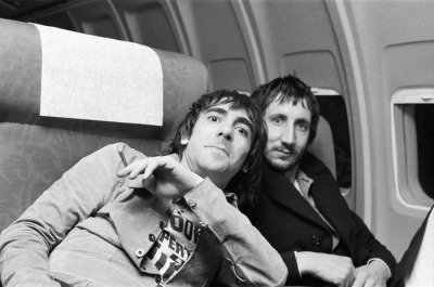 Keith Moon and Pete Townshend on their plane for the flight home. December 1973.