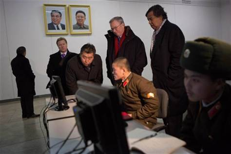 looking at North Korean soldiers working on computers