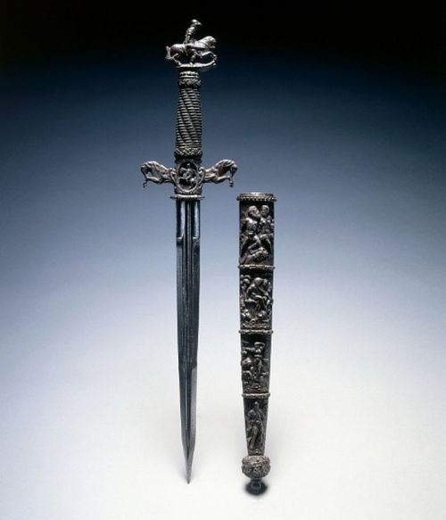 Dagger Dated: 17th century (16th century blade) Culture: Switzerland and/or France Medium: steel and wire; chiseled quillions and pommel Measurements: Overall - l:44.30 cm (l:17 7/16 inches) Wt: .46 kg; Quillions - w:9.20 cm (w:3 9/16 inches)  Source: © 2012 Cleveland Museum of Art