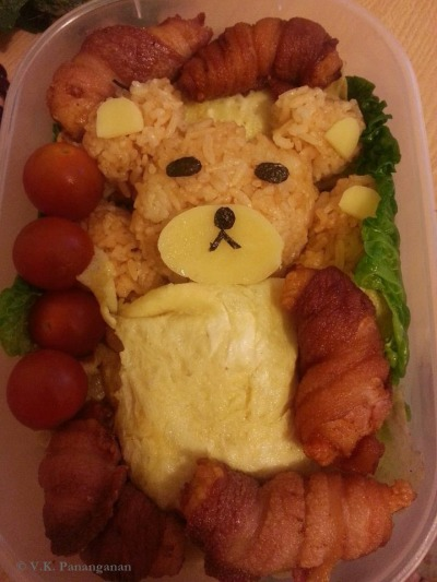 Taaaddaaaa~~ my first bento!!! Teeehheee! Actually, this is Rilakkuma but it doesn't look like Rilakkuma at all because I was in a hurry to make it. But anyways, think of it as an ordinary bear. :))) What do you think guys? Kawaii or fail? -.-""