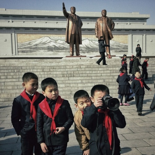North Korean school boys play with an Associated Press photographer's professional camera on Mansu Hill in Pyongyang, while he snaps them on his smartphone using Instagram. In January foreign visitors were allowed to bring mobile phones into North Korea for the first time and this week the local service provider, Koryolink, is allowing foreigners to access the Internet on a data capable 3G connection on mobile phones. Photograph: David Guttenfelder/AP