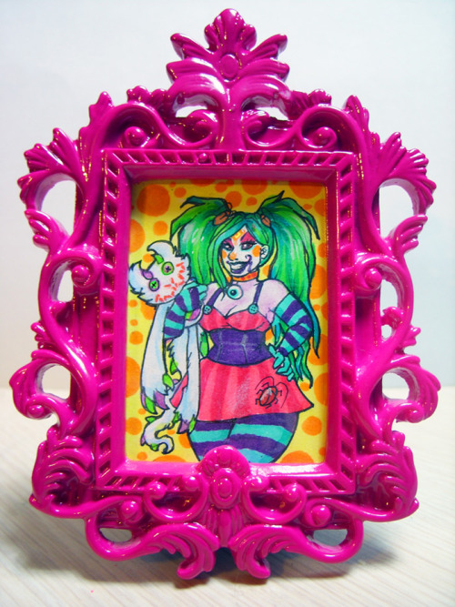 "A tiny Boogle & Kittymonster in one of many frames I got at Michael's. The drawing area is only about 1.5x2.5"". Inked with extra-fine Faber-Castell indian ink pen, colored with Copic brush pens & Prismacolor pencils, touched up with white gel pen. Next time I'll be using a needle to touch up with this, as it comes out in too-big globs most of the time x_x"