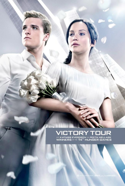 New Catching Fire Poster Proves Katniss Has Horrid Taste In Wedding Dresses