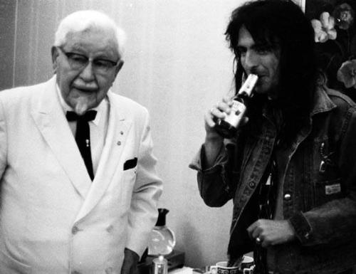 look it's colonel sanders and alice cooper hahahha