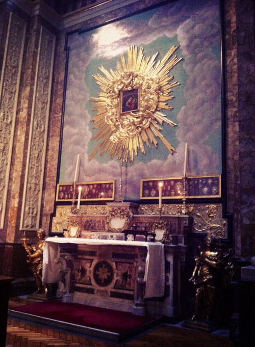 The altar of Our Lady of Good Counsel in the Oratory church in London.The candles and Mass cards indicate that the altar has been prepared for a Latin Low Mass.