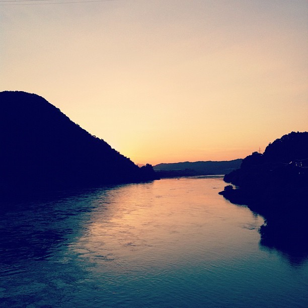 A sunset over a river in Chungju