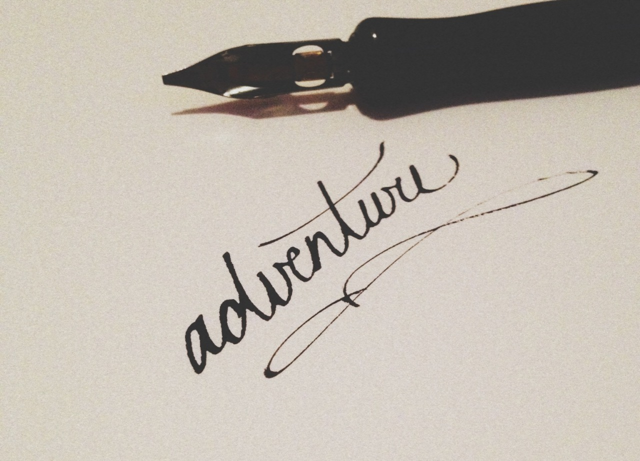 betype:  life is an adventure. calligraphy.