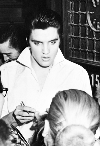 "vinceveretts:  Elvis signing autographs for fans outside Junco Studios, after shooting a new ending for ""Love Me Tender"", New York, October 29th 1956."