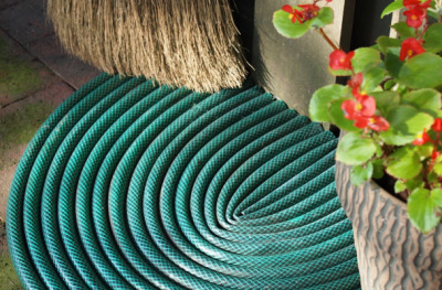"DIY project du jour: Turn a broken garden hose into a door mat. A tutorial, on Mark Kintzel's blog here, mentions the idea of making something like this with a new ""dollar store door mat"" as a base. Instead of buying something new, I'd check with my neighbors to see if someone has an old door mat they'd let me reuse."
