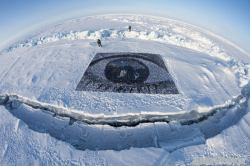 "via Save The Artic ""The eyes of the world, at the top of the world, watching over the world: over a thousand portraits of members of the Save The Arctic movement make up a giant eye on the North Pole, in a statement of defiance against destructive industry in the Arctic."" - JR"