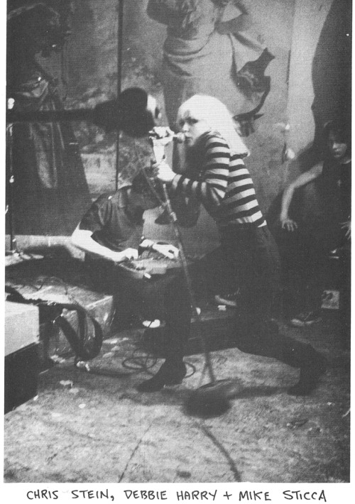 zombiesenelghetto:  Blondie: Debbie Harry, Chris Stein and roadie Mike Sticca performing at Punk Magazine's Benefit Concert, photo Godlis, CBGBs, NYC 1977