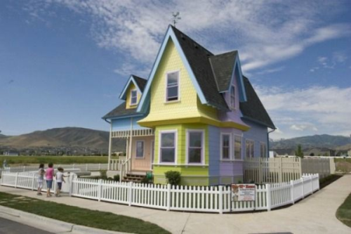""" 'Up' House  Carl and Ellie's house from the movie 'Up' is now an actual home ready to be moved into. The house was built by Bangerter Homes in the city of Herriman, Utah. The cost of the home is $390,000. Throughout the home you will find that it is true to the movie; it even has the same mailbox. The basement does feature a home theater and two bedrooms. The basement bedrooms are decorated in Disney Princess and 'Toy Story' motifs"""