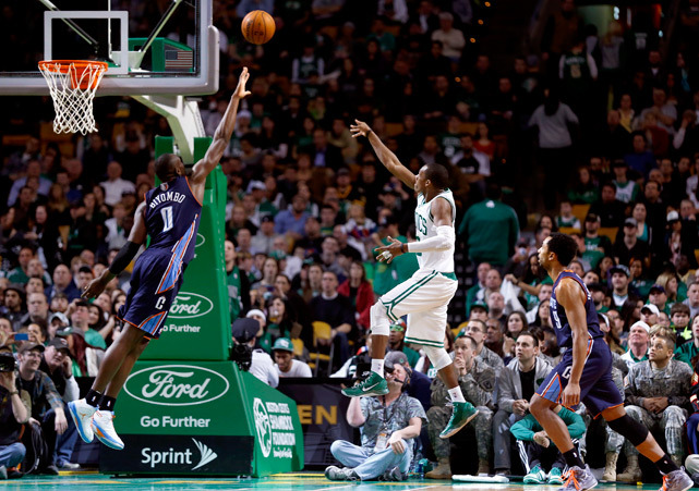 Celtics guard Rajon Rondo shoots over Bobcats forward Bismack Biyombo during the second half of Monday's game in Boston. Rondo scored 17 points with 12 assists and 10 rebounds as the Celtics won 100-89. (AP Photo/Charles Krupa) GALLERY: Rare Photos of Rajon Rondo
