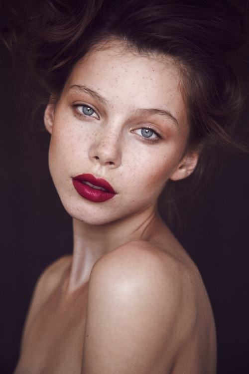 Deep rouge lips.