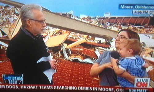 "globochem:  Wolf Blitzer was attempting to interview this woman, but decided to just allow her baby to grab the microphone and babble into it, drowning out anything resembling an interview, while continuing to ignore the baby and the fact that it's ruining everything. Keep it top-notch, CNN. BUT THEN: Wolf just asked her if she thanked the lord for surviving the tornado; ""You have to thank THE LORD; don't you thank the lord?!"" To which she responded, practically unfairly embarrassed: ""actually, …I'm an atheist."" [video posted already, here] AWESOME LADY. SUCK IT, WOLFMAN"