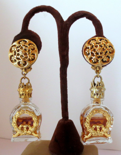 Perfume bottle earrings! Since I don't wear perfume, I'd change the color of the liquid inside the bottle to go with my outfit!