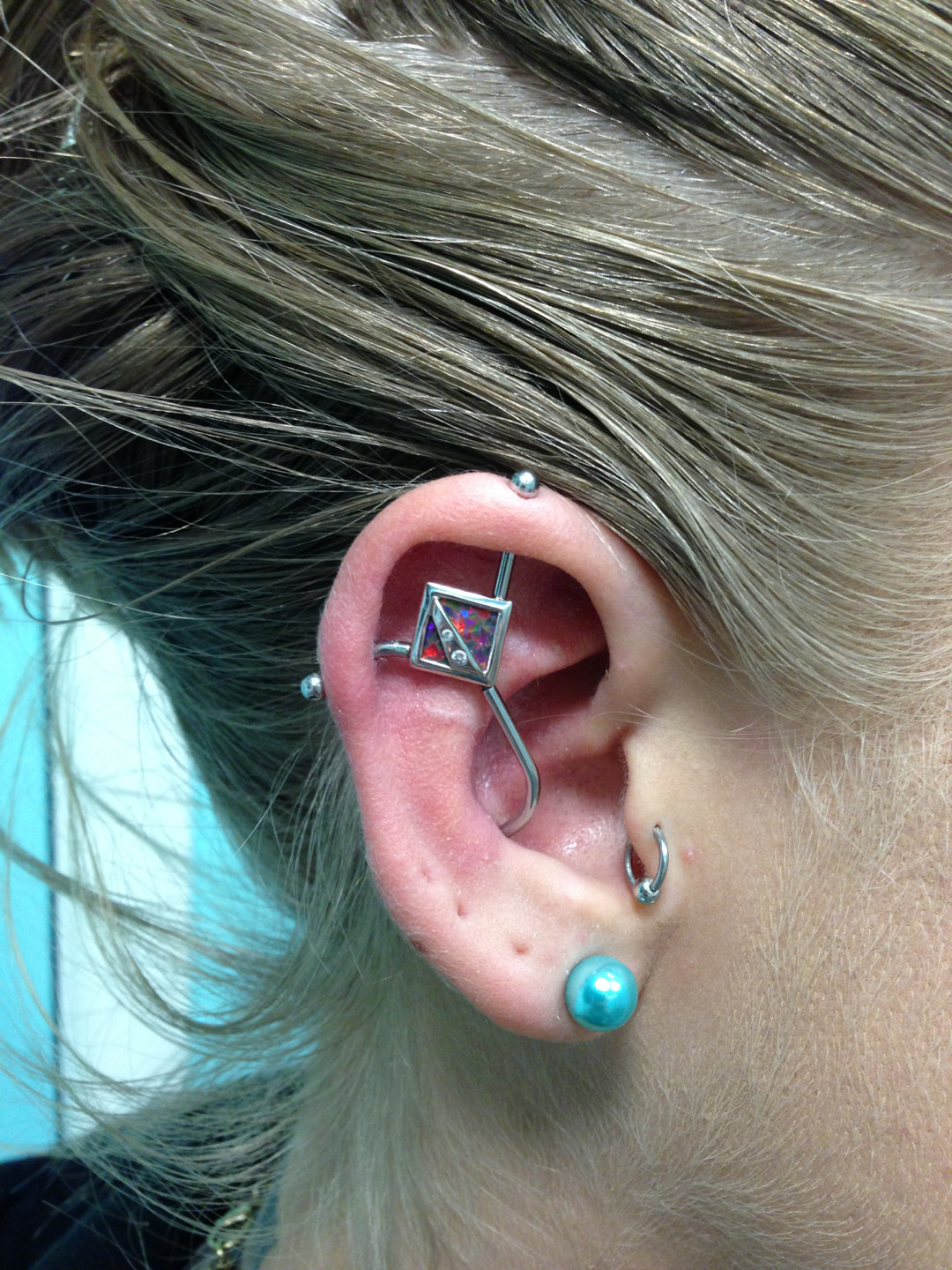 Here's a healed triple point with red opal and cz's set in white gold made by Body Vision Los Angeles.