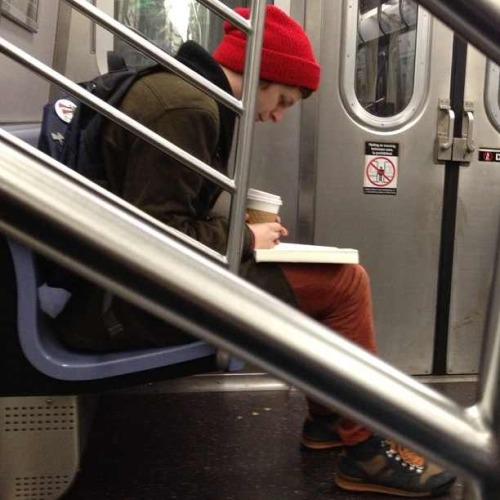 oasyys:  howdiditgoagain:   Michael Cera calmly reading on the train  i fucking love MIchael Cera   This picture makes me happy