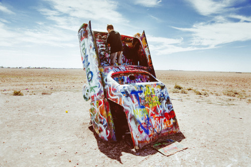 Cadillac Ranch, Kid. on Flickr.circa summer 2012.