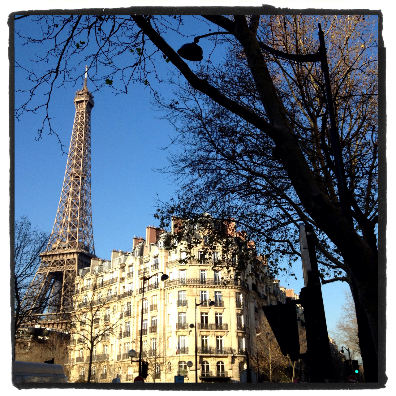 A crisp, cold morning this morning in Paris with the Eiffel Tower against a cloudless blue sky.  — Anon