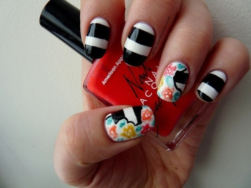 Cute floral and striped nails by Brittney W.!