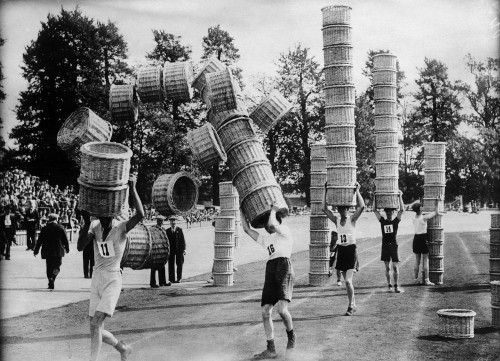 Men participate in a basket carrying contest in London (Keystone/Corbis) The Weirdest Photo Research of 2012 - The New Yorker