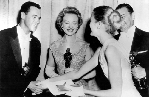 Grace Kelly congratulates Oscar winners Jack Lemmon (Mister Roberts), Jo Van Fleet (East of Eden), and Ernest Borgnine (Marty) at the 28th Academy Awards, 1956.