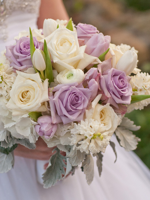 Soft lavender and cream roses, with tulips, fragrant hyacinth blossoms, and ranunculus, accented with Dusty Miller leaves. Image by Verve Studios