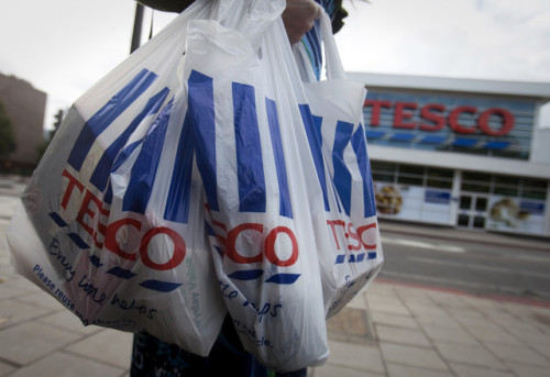 Hey readers in Britain and Ireland: If you bought your burgers from Tesco, there's a chance they might include horse meat. Holy cow. (photo by Simon Dawson/Bloomberg)