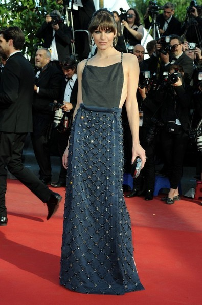 PRADA: DRESSES MILLA JOVOVICH AT THE CANNES FILM FESTIVAL  Smokey eyed Ms. Jovovich serving an amazing floor length look from Prada at the 66th annual Cannes Film Festival. Something in that expression (or maybe the many star turns we've seen her take in action movies) suggests she might discard clutch and hoik up her exquisitely embroidered skirt to kick our asses. Maje!  www.prada.com by Vincent Levy