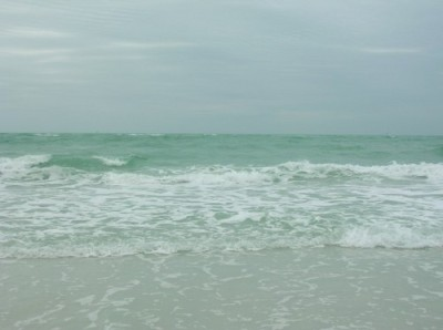Siesta Beach, Fla — The crystal-clear beach remains empty as spring breakers enjoy the experience without jumping in the water.