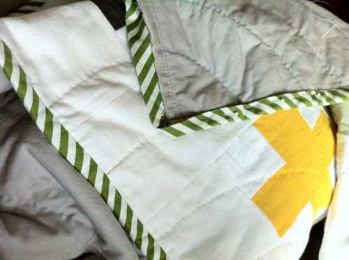 On a whim when I was pregnant I started sewing a quilt for my kiddo. I thought it was going to be a really simple baby blanket/mat, the kind you put on the floor for them to play on. I made little squares out of scraps of old fabric and odds and ends— an old button-down shirt of Dave's, leftovers from a dress I made. And then as I was working on it it slowly got bigger and more elaborate. And I thought I would just tie it instead of quilting it, or at the very least machine quilt it, but that seemed not as nice so I hand-quilted it. And then because it was nicely hand-quilted, I decided to do the nicer hand-finished binding. In this way I have been working on the super simple baby quilt for months.   It's almost done, though, and I'm really, really excited.