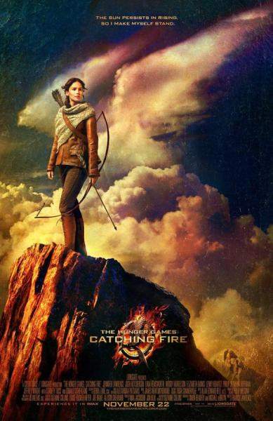 """The sun persists in rising, so I make myself stand."" New Catching Fire poster. Showing on November 22.  Can't wait to see it!!"