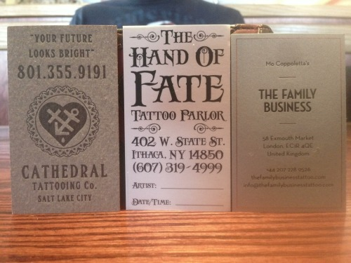 These are some cool business cards I picked up today at the Rochester Tattoo Expo! The one on the left is fantastic. Not sure about the back side of the middle one, but the front has a pretty cool illustration.