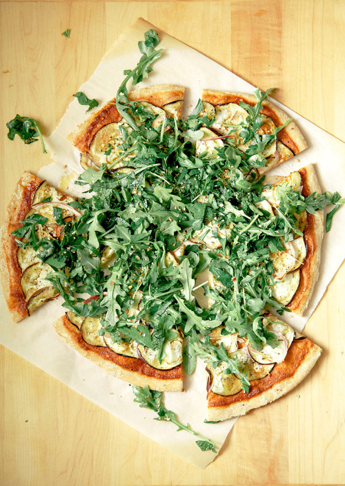 crispy eggplant + harissa flatbread with greens  click here for recipe