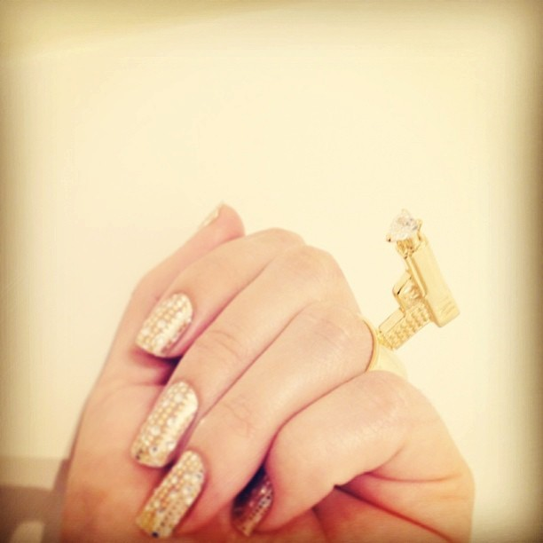 Cupids love gat. Designed By #melodyehsani #Gold plated gun ring w/heart shaped crystal. Avail now on @karmaloop & next week on melodyehsani.com